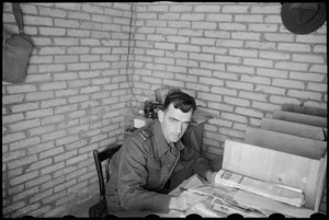 Editor of the NZEF Times, Mr H L Heatley at his desk in Cairo, Egypt, World War II. Photograph taken by George Bull. Alexander Turnbull Library, http://natlib.govt.nz/records/22890415