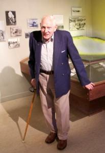 Veteran Noel l Bunn standing in front of the Museum's model of Monte Cassino