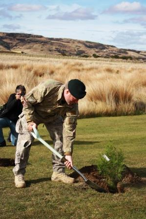 Lt Col Barker planting the Lone Pine seedling at the Museum