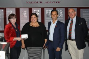 Keily Evans and Matt Sale (middle) of the Public Trust present the medals to Assistant Curator Heraldry, Liz Mildon. Also pictured on right, Col (Rtd) Ray Seymour.